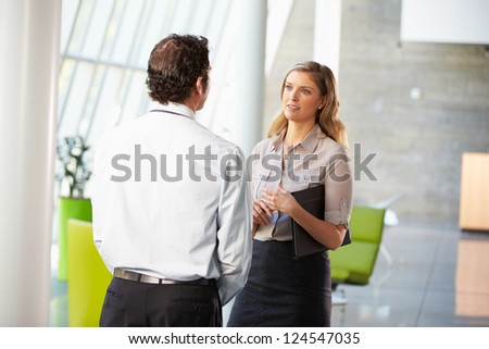 Businessman And Businesswoman Having Meeting In Office