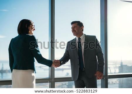 businessman and businesswoman...