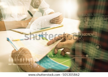 Businessman and businesswoman talk and write about something in meeting subject on paper document with film effect.