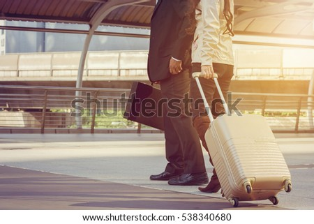 Businessman and businesswoman traveler with luggage at city background, Business People Commuter Walking City Life Concept. #538340680