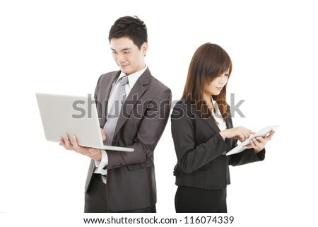 businessman and businesswoman using laptop and tablet pc