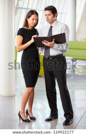 Businessman And Businesswomen Having Meeting In Office