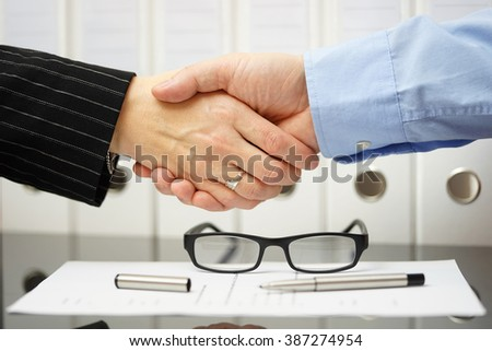 Businessman and client are handshaking over very good agreement