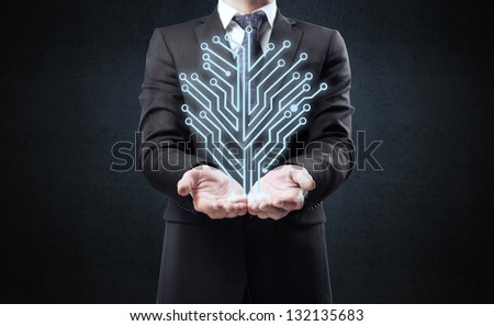 businessman and electronic circuit board