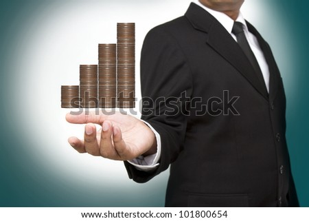 businessman and graph from money