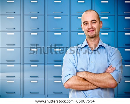 businessman and  image of blue file cabinet