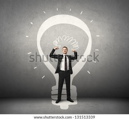 businessman and lamp drawn on the wall