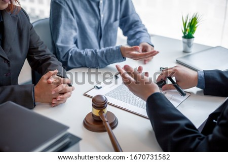 Businessman and lawyer discuss the contract document. Treaty of the law. Sign a contract business.
