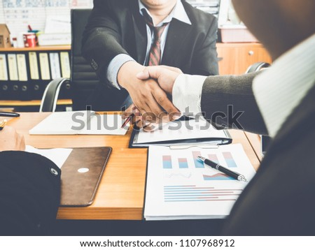 Businessman and lawyers handshake after meeting, financial contract deals and problematic business deals with government organizations.