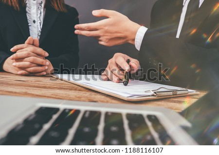 Businessman and Male lawyer or judge consult having team meeting with client, Law and Legal services concept,warm colours sun light