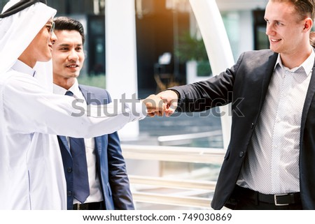 Businessman and partner giving fist bump hand #749030869