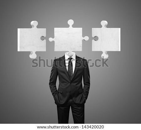 businessman and puzzle pieces