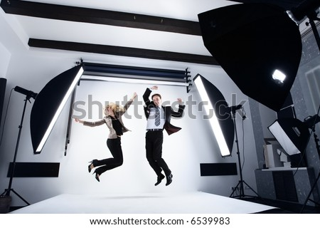 Stock Photo businessman and woman in a modern photo studio