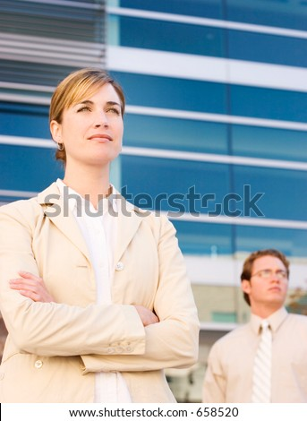 businessman and woman looking in the same direction