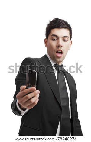 Businessman answering a phone call, isolated over a white background