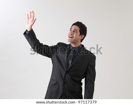 businessman arm raised waving in the air