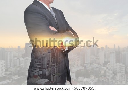 Businessman arms crossed and stand up, cityscape and sunset as thinking vision of leader concept. #508989853