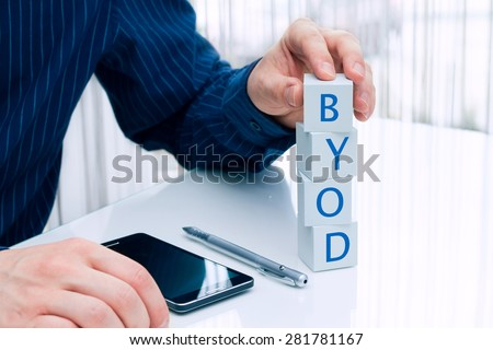 Businessman arranging small blocks with word