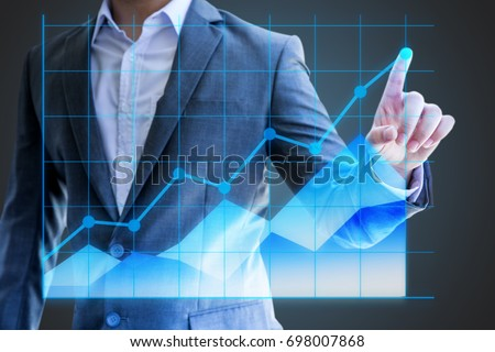 businessman asian use hand show line graph holographic statistics  sales economics company in quarter this year success to investor for reliability #698007868