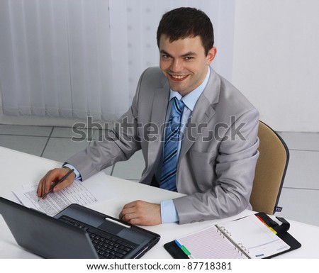 Businessman at office desk busy