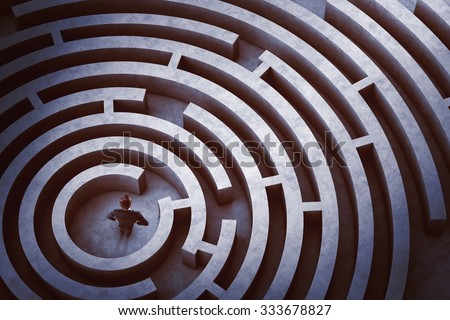 Businessman at the center of a maze - Shutterstock ID 333678827