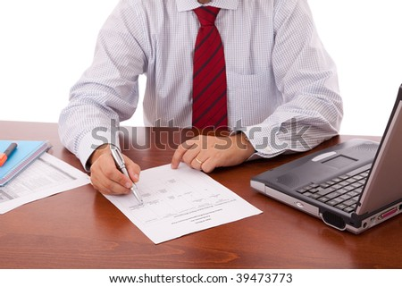 businessman at the office signing a contract