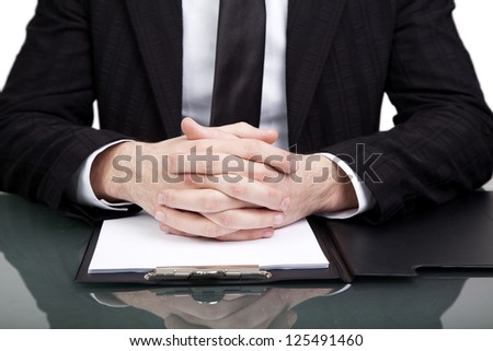 Businessman at the office with his hands folded