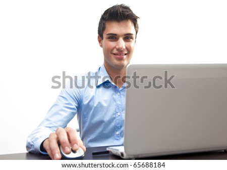 Businessman at work in his office with his laptop