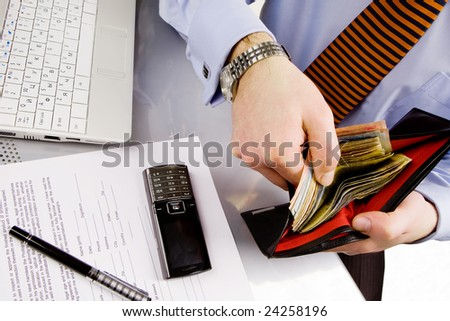 Businessman at work place counting money