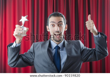 Businessman awarded with star award - stock photo