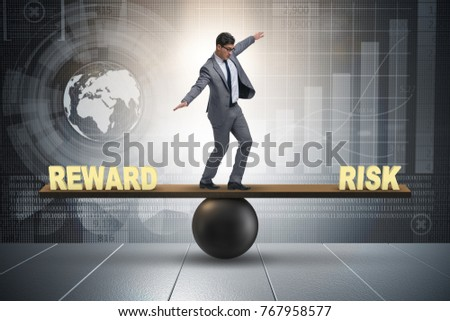 Businessman balancing between reward and risk business concept #767958577