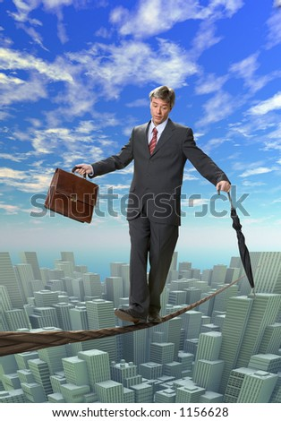Businessman balancing on rope over a big city