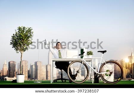 Businessman Bicycle Eco-Friendly Environmental Concept #397238107