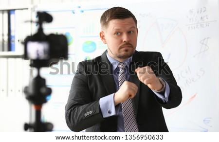Businessman blogger boxing online coach screaming intro camera concept #1356950633