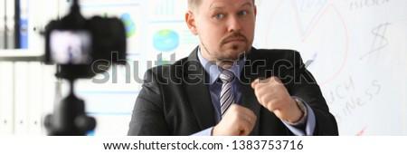 Businessman blogger boxing online coach screaming intro camera concept #1383753716