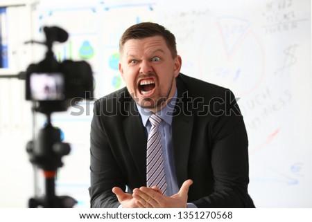 Businessman blogger online coach screaming intro camera concept #1351270568