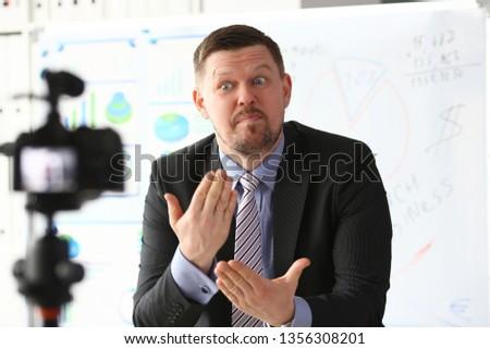 Businessman blogger online coach screaming intro camera concept #1356308201
