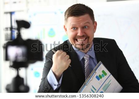 Businessman blogger online coach screaming intro camera concept #1356308240