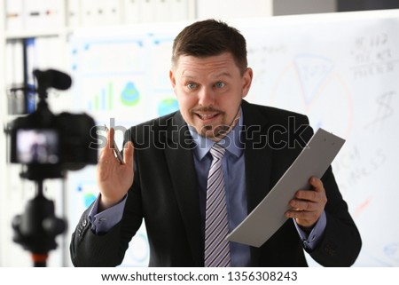 Businessman blogger online coach screaming intro camera concept #1356308243