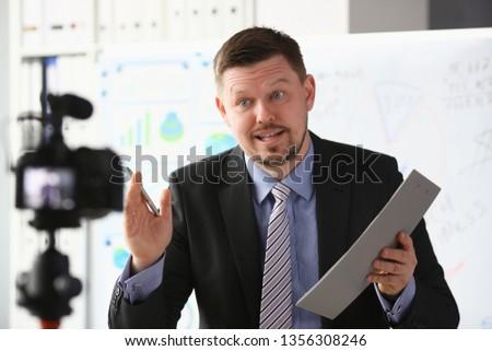 Businessman blogger online coach screaming intro camera concept #1356308246