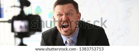 Businessman blogger online coach screaming intro camera concept #1383753713