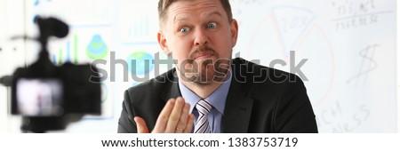 Businessman blogger online coach screaming intro camera concept #1383753719