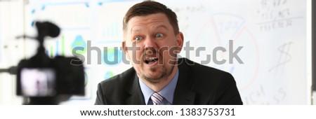 Businessman blogger online coach screaming intro camera concept #1383753731