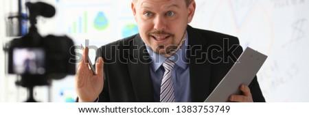 Businessman blogger online coach screaming intro camera concept #1383753749