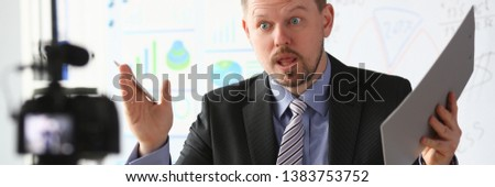 Businessman blogger online coach screaming intro camera concept #1383753752