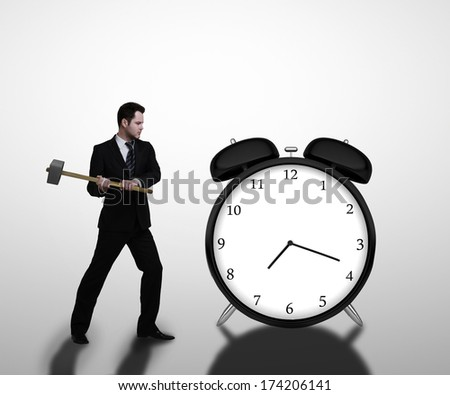 businessman breaks sledgehammer big clock  on a white background