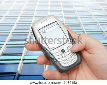Businessman browsing internet using advanced mobile phone