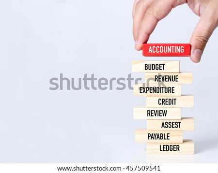 Businessman Building ACCOUNTING Concept with Wooden Blocks