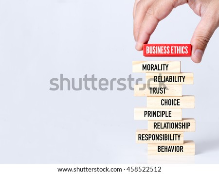 Businessman Building BUSINESS ETHICS Concept with Wooden Blocks #458522512