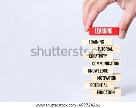 Businessman Building LEARNING concept with Wooden Blocks